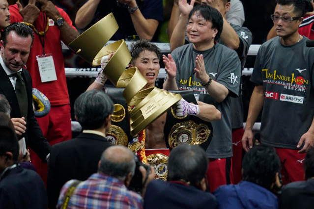 Naoya Inoue (C) of Japan celebrates with the trophy after defeating Nonito Donaire of the Philippines at the WBSS Bantamweight Final on Thursday in Saitama, Japan. (Photo by Toru Hanai/Getty Images)
