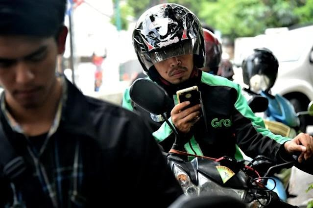 Grab has gone from a humble beginnings as a taxi-hailing firm to a Southeast Asian tech giant