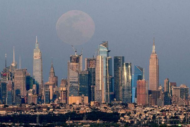 PHOTO: The full moon, known as the 'Super Pink Moon', rises over the skyline of New York City, seen from West Orange, in New Jersey, April 26, 2021. (Eduardo Munoz/Reuters, FILE)