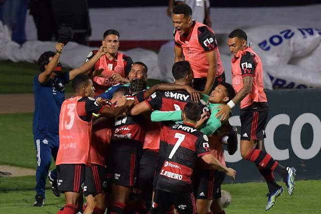 Flamengo's players celebrate a goal scored by Bruno Henrique against Sao Paulo during their Brazilian Championship final date football match at Morumbi stadium, in Sao Paulo, Brazil, on February 25, 2021. (Photo by NELSON ALMEIDA / AFP) (Photo by NELSON ALMEIDA/AFP via Getty Images)